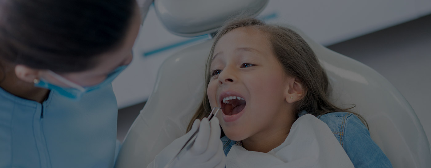 Child receiving dental care in South Dallas