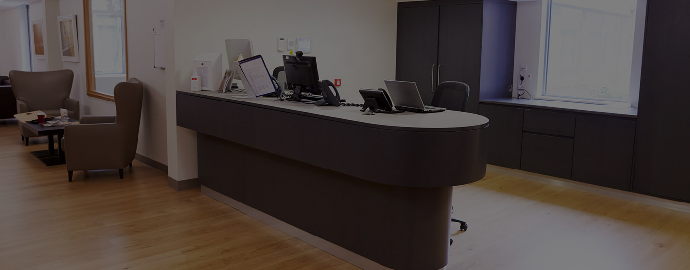 Welcoming reception desk in dental office in Garland
