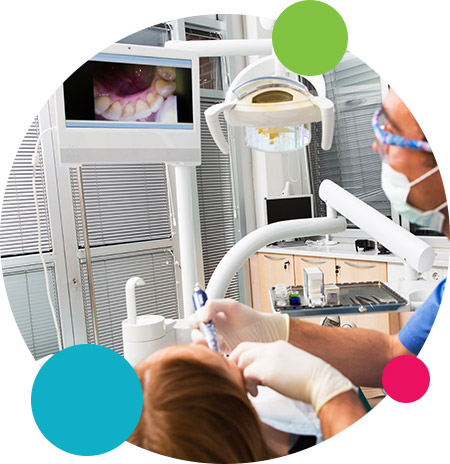 Dentist and patient looking at intraoral photos in Dallas
