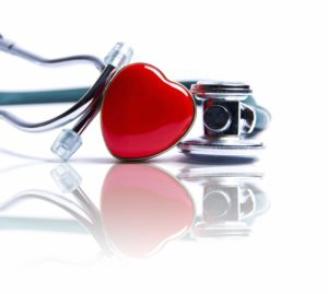 love heart next to a stethoscope