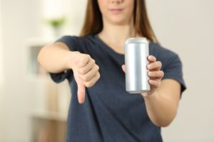 woman holding energy drink in hand