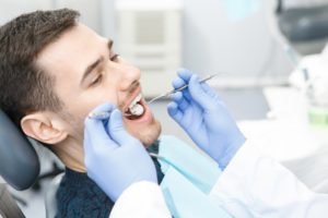 a male patient having his teeth checked