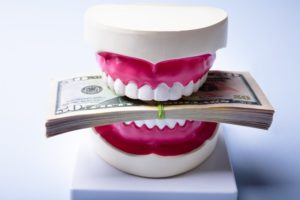 teeth with a stack of money